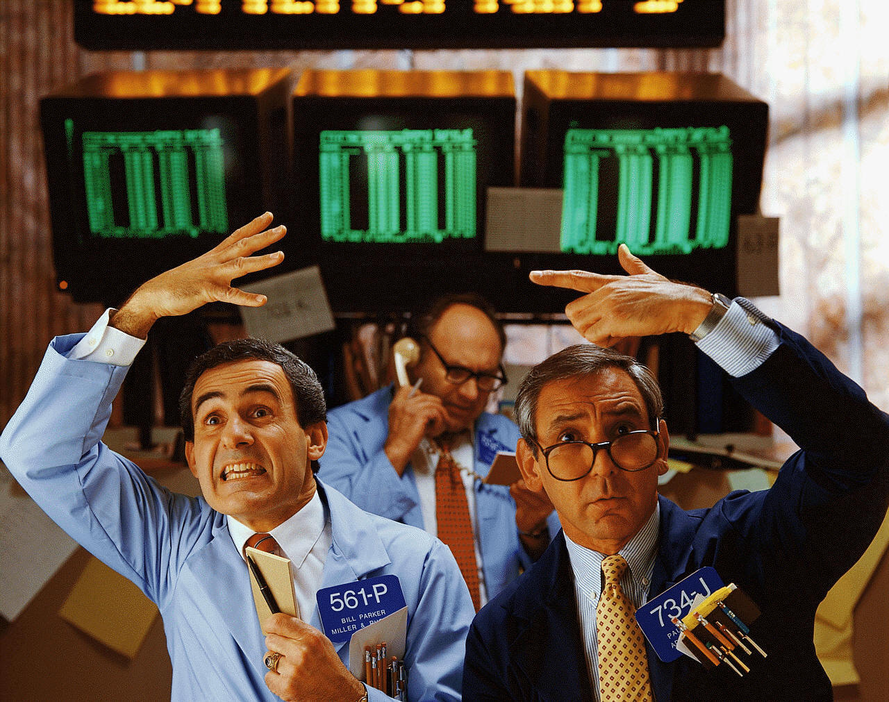 Traders watch world markets especially oil, gold, and equities